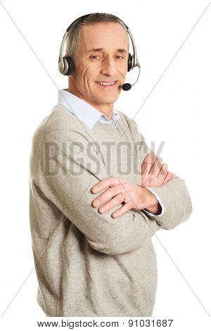Side view of call center man with folded arms.