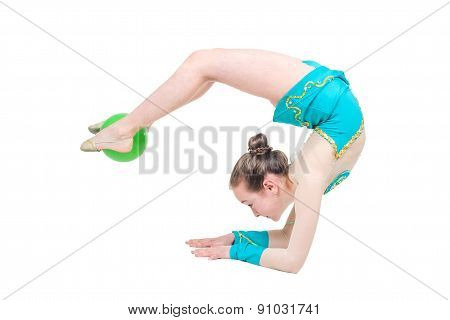 Little girl gymnast with green ball