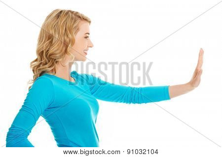 Side view woman pulling imaginary screen.