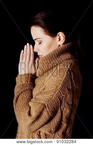 Portrait of a woman praying to God.