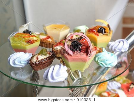 Wedding decoration with pastel colored cupcakes and muffins