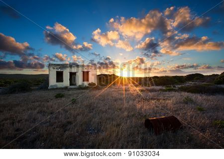 Old Small Deserted House In Field With Cloud Sunset Landscape