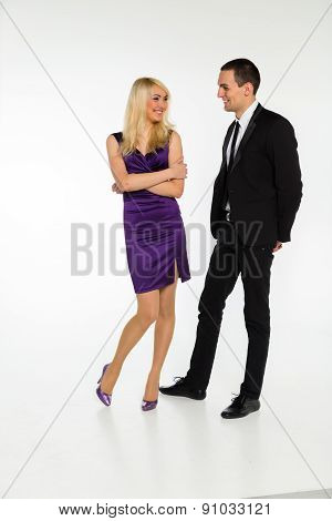 Man and woman posing on a white background.