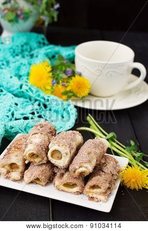 Cookies Rolls With Rhubarb And Cinnamon On A Dark Background