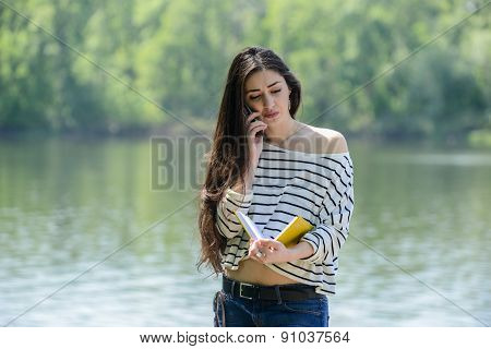 unhappy girl with mobile phone
