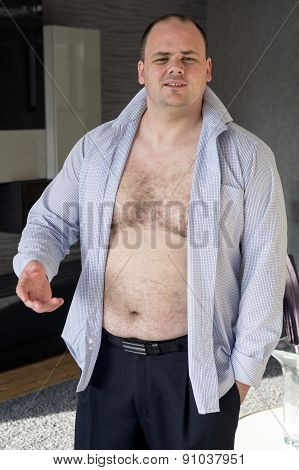 Man Standing In His Living Room With Open Shirt