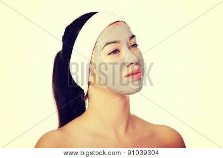 Relaxed woman with  a deep cleansing nourishing face mask applied to her face, beauty and skincare concept