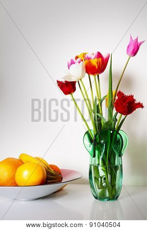 Still life with tulips and fruits