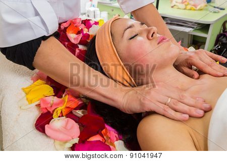Cosmetology spa facial. Beautiful brunette in a spa salon.