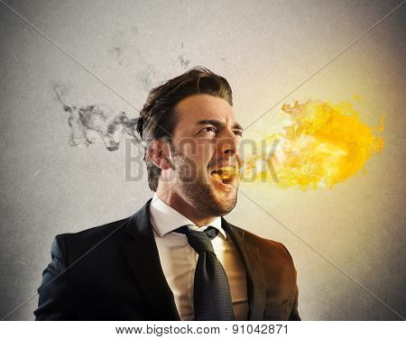 Furious businessman spitting fire