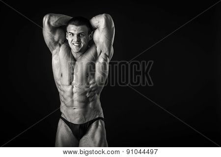 Strongman on a black background. Muscled. strong man