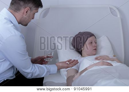 Father Giving Ill Daughter Medicines