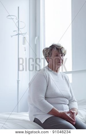 Senior Lady In Hospital Room