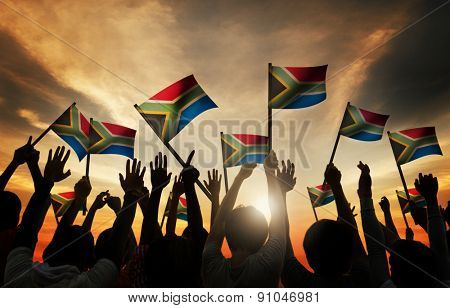 Group of People Waving South African Flags in Back Lit Concept