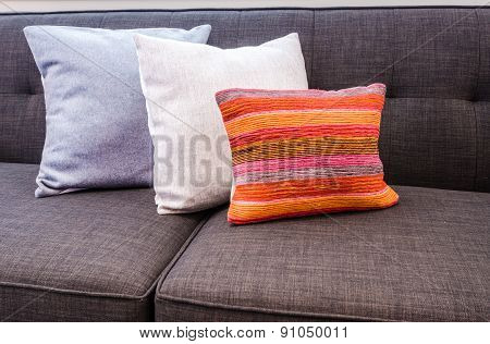 Interior design with couch, sofa with colourful designer cushions, pillows