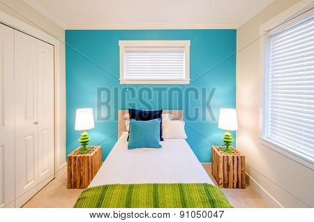Modern blue bedroom interior design in a luxury house with reclaimed wood bedside tables.