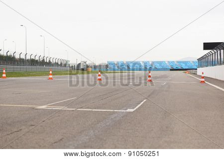 racing, motosports, extreme and motoring concept - empty speedway on stadium