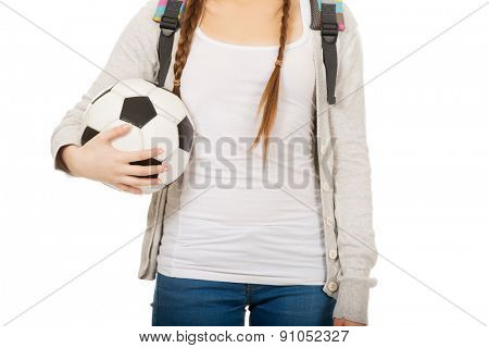 Teenager with schoolbag and foot ball.