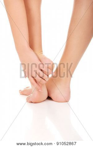 Woman cares about her feet.