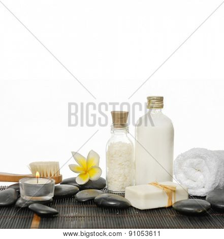 Spa still life with frangipani, soap, towel on mat