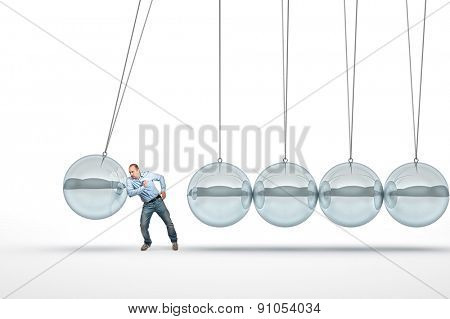 businessman push 3d abstract newton cradle