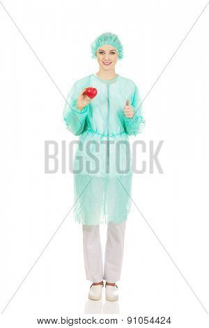 Female surgeon doctor holding heart model.