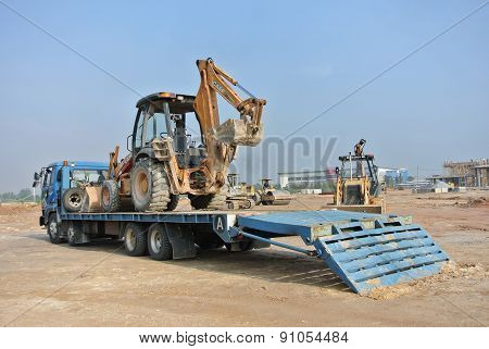Excavator machine on the trailer lorry