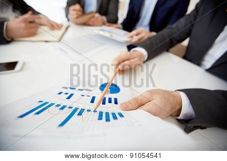 Businessman pointing at paper with financial data