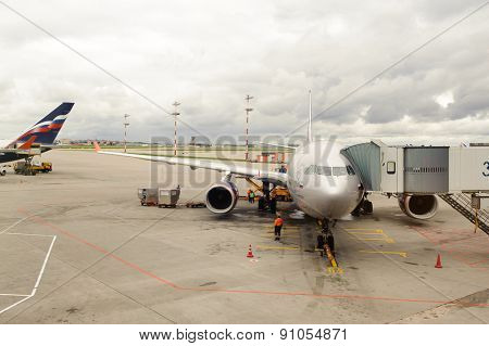 MOSCOW, RUSSIA - SEPTEMBER 25, 2011: jet aircraft docked in Sheremetyevo airport. Sheremetyevo International Airport is one of the three major airports that serve Moscow