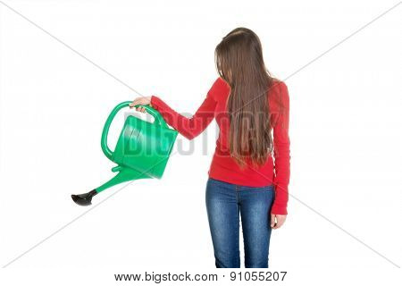 Happy woman holding a watering can.