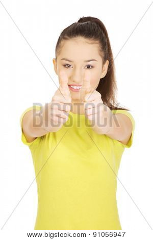 Young happy student woman showing thumbs up.