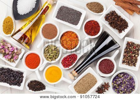 Various spices on white wooden background. Top view