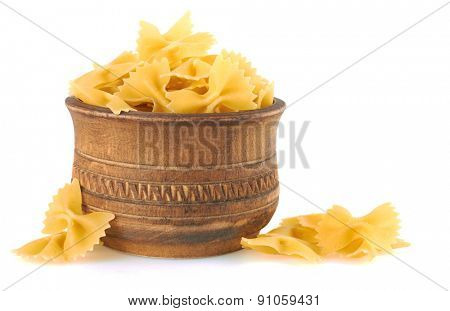 Farfalle italian pasta in wood bowl, isolated on white background