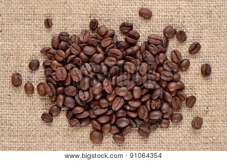 Coffee Beans In A Sacking Background