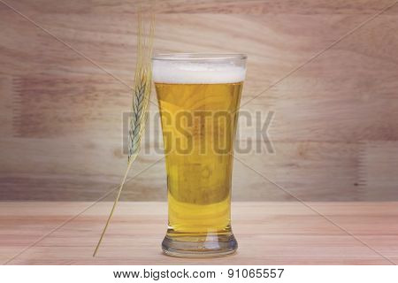 Glass Beer And Bale On Wood Background