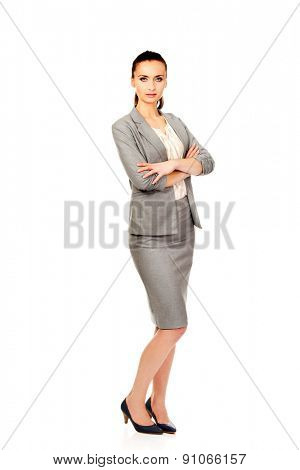 Beautiful confident businesswoman with folded arms.