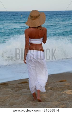 Girl In Hat On The Beach.
