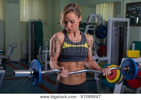 Women's sports. Strong girl in the gym.