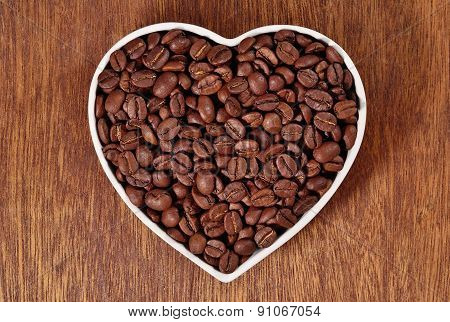 Coffee Beans In Plate In The Form Of Heart
