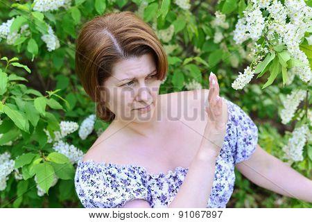 Woman With Allergies In  Flowering Spring Park