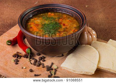 Oriental soup. Eastern food. Arab food. Soup with bread.