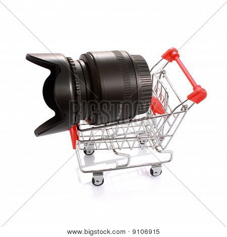 Camera Lens With Hood In Shopping Cart Isolated On White
