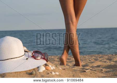 Legs Of A Girl On A Beach