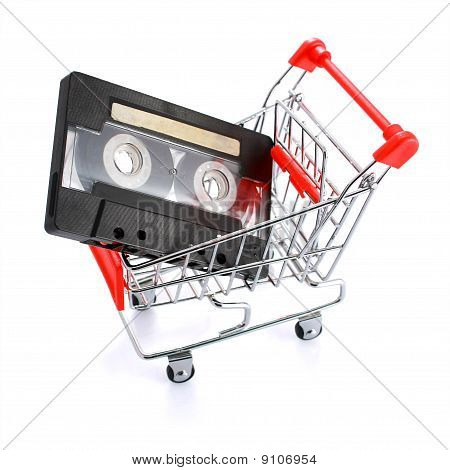 Compact Casette In Miniature Shopping Cart Isolated
