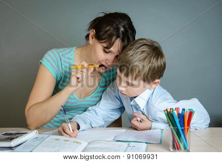 mother helping his son to do homework
