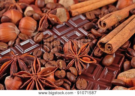 Coffee, Chocolate, Star Anise, Hazelnuts And Cinnamon Sticks Close Up
