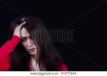 Stressed young women,student portrait, sad, bothered, holding hand on her head isolated on black bac