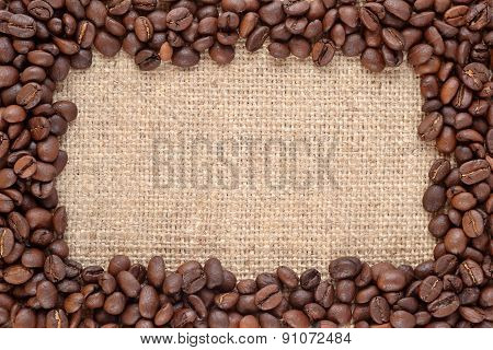 Frame Of Coffee Beans In A Sacking Background