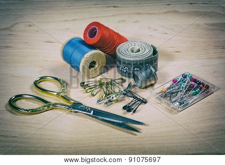Scissors, Thread, Pins. Photo In Old Image Style