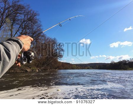 Fisherman with spinning in his hand.
